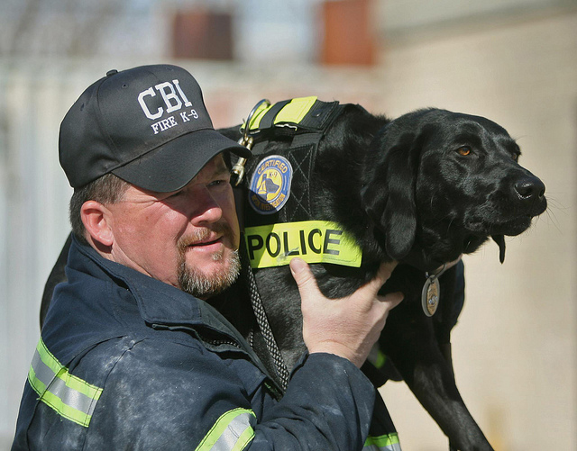 Photo of K9 Arson Dog, Sadie, and her handler Agent Jerry Means of the Colorado Bureau of Investigations.